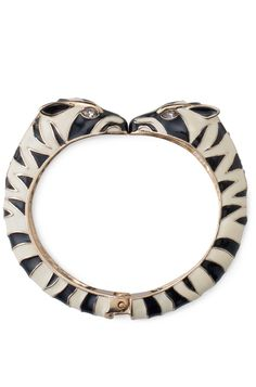 Stella & Dot Kalahari Bangle Bracelet $79 - A pair of enamel zebras detailed in gold plating with CZ and glass stones meet nose-to-nose in a delightful statement bracelet. To see more jewelry ,& accessories go to my website www.stelladot.com/denisedaunt Similar in feel to the Juicy Couture Zebra Bangle
