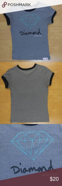 "Diamond Supply Women's Short Sleeve Gray Tee Small Diamond Supply Women's Short Sleeve Gray Tee Small. Large logo on front, solid gray on back. Neckline and sleeve trimmed with black. Item is pre owned, minimal wear from normal use and wash. No rips or stains. Item comes from smoke free home. Underarm to Underarm: 16"" (on flat surface) Lenght of shirt: 21"" Diamond Supply Co. Tops Tees - Short Sleeve"