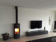 Log Burner Living Room, Living Room Tv Unit, Living Spaces, Rooftop Terrace Design, Freestanding Fireplace, Pellet Stove, Flat Ideas, Wood Burner, Fireplace Design