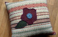 appliqued pillow cover...wool fair isle knit with hand stitched flower applique  ...natural shades of beige, sage green, rust, pale blue  ...flower is