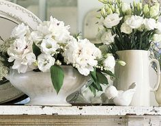 While browsing flea markets and antique shops, pick up white ceramic urns and pitchers to use as vases for white flowers. The monochromatic pairing looks elegant when grouped with other found objects in the same hue.