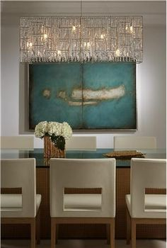 dining room - contemporary art work & furnishings with an timeless color palette set aglow with a dazzling modern chandelier - lovely