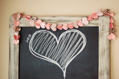 Soft pinky peach paper hearts stitched together with rustic white heart chalkboard -- soft, sweet pink Valentine's Day decoration
