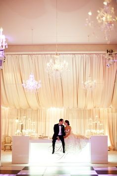 So much light and glamour in this decor. The chandeliers and monogram are adorable. #decor #weddingday #reception