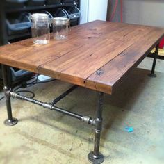 Weekend project inspired by Barn Wood Cast Iron Pipe Coffee Table by JSReclaimedWood on Etsy.