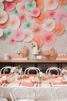peach & off white with pops of mint    I like this cause we could use those cheap, expandable paper snowflakes for her....