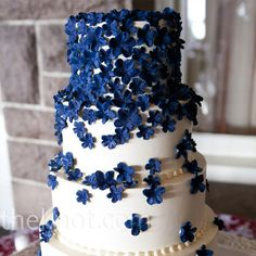 Navy-blue sugar flowers cascaded down the tiers. This but in purple would be great