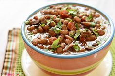 Slow Cooker Charro Beans -- flavored with bacon, garlic, tomatoes, green chiles, jalapeños, cilantro, and spices -- are the perfect pinto beans to accompany your favorite Mexican entrees! A few days ago I shared my recipe for King Ranch Chicken Casserole, which just so happens to be one of my family's very favorite comfort food classics. And if you saw that post, you may have noticed a side of tasty-looking pinto beans adorning the casserole plate. Well, those beans weren't