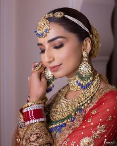 A regal bride wearing stunning polki earrings with uncut emerald and saphire drops aired with pearls! Dont miss her stunning bajuband style mathapatti too C) Israni Photography #wittyvows #indianwedding #indianbride #kundanjewellery #indianjewellery #bridaljewellery #bridalearings #indianweddinginspiration #indianweddingbuzz #weddingideas Bridal Bun, Bridal Hairdo, Bridal Style, Modern Wedding Vows, Wedding Reception, Bridal Necklace, Bridal Jewellery, Bridal Looks, Marathi Bride