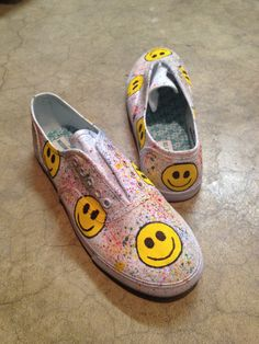 Put on a happy face with these hand-painted canvas lo-tops. Inspired by trends from the 70s, 90s and FW12 runway these signature sneakers will become a spring and summer staple. Perfect for festivals or outdoor fun these smiley face shoes will let you share a smile with every step. Made from white canvas sneakers, painted and sealed three times with a clear protective seal these sneakers are a decorative and durable choice for all season. ~ $30