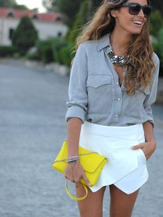 Casually chic asymmetrical skirt and button up. Complete with yellow clutch and necklace= #fashion #style