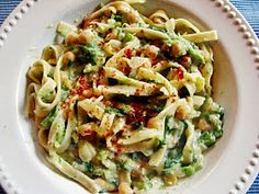 TAGLIATELLE WITH RAPINI, ONION, CHICKPEAS & CREAMY WHITE BEAN FLOUR-BASED VEGAN BECHAMEL