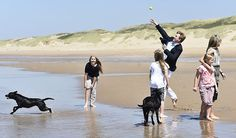 Queen Maxima and King Willem-Alexander, with Princess Amalia and Princess Alexia and Princess Ariane with dog Skipper pose for the media during the annual summer photo session on the beach near Meijendel in Wassenaar on July 10, 2015