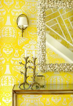 "Love this mirror, and the Clarence House Paper in yellow. like the combonation of using the shell mirror with the ""twig"" candlesticks"