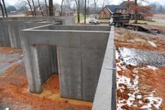 A concrete safe room in a basement