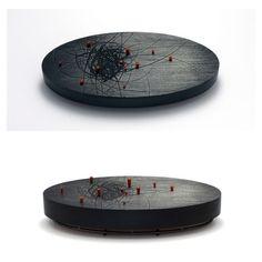 "Julia Turner ""Black Knot"" brooch, 2008. Wood, oxidized sterling silver, stain. 3.7 x 1.8 x 1 in (9.5 x 4.5 x 2.5 cm)."
