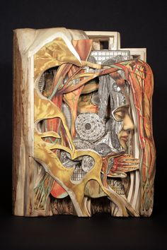 """Amazing book carvings  """" ... what will happen with all the old traditional books once they are available online? Is there a use for them anymore?"""""""