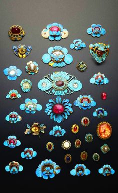 Collection of gilt metal and Kingfisher appliques formed as flowerheads and butterflies, mounted with coloured cabochons and other stones, Qing Dynasty, China.