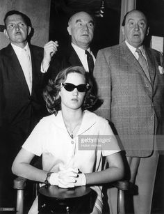 Cheryl Crane, daughter of actor Lana Turner, sits in a chair with her hands folded in her lap, wearing dark sunglasses, while three unidentified men stand behind her at the time of her trial for the murder of gangster Johnny Stompanato. Hollywood Actor, Hollywood Actresses, Classic Hollywood, Old Hollywood, Cheryl Crane, Frank Nitti, Albert Anastasia, Mickey Cohen