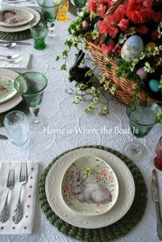 Easter table with bunnies, eggs and and Easter basket centerpiece #Easter