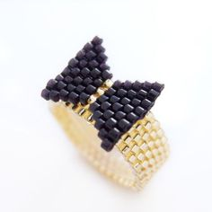 Its a black tie event, a black bow ring on your finger that is! Our beaded black bow ring is dripping with tasteful glamor of glossy black and Beaded Jewelry Designs, Bead Jewellery, Diy Jewelry, Simple Jewelry, Jewelry Ideas, Loom Beading, Beading Patterns, Weird Jewelry, Beaded Jewelry