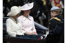Britain's Camilla, Duchess of Cornwall, left, Kate, Duchess of Cambridge, and Prince Harry leave Buckingham Palace in a horse drawn carriage for the Trooping The Colour parade, at the Horse Guards Parade in London, Saturday, June 15, 2013.  Queen Elizabeth II is celebrating her birthday with traditional pomp and circumstance —but without her husband by her side.Photograph by: Sang Tan, AP Photo