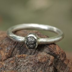 Sterling silver hand textured ring with genuine rough diamond in silver bezel setting