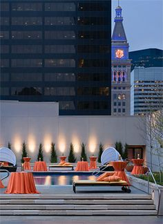 Our outdoor rooftop pool terrace at night features beautiful views of Downtown Denver, including the historic clocktower.