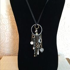 """Bohemian Hippie Charms Necklace This handmade necklace is made of assorted metals in a variety of hearts, circular discs, chains, and clear crystals. It's a set of two individual charms layered on a 21"""" black velvet double lobster claw closure. The charms are removable so you can use this velvet cord for any type of charm. So cool!!  This looks really good paired with a black T-shirt nice crisp jeans cute black booties and a great handbag!  (Checkout my closet for bags).    Make sure your…"""