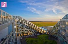 8House, located in Southern Ørestad.  The apartments are placed at the top, while commercial offices at the base of the building.  The horizontal layers have achieved a quality of their own.  The apartments benefit from sunlight, fresh air and a spectacular view, while the commercial space merges with life on the street