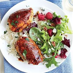 High-flavored seasonings coat this easy, 40-minute meal of Spiced Chicken Thighs with Garlicky Rice. Serve with Raspberry and Blue Cheese...