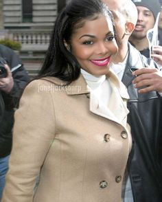 """""""Good morning. It's a rainy day out. But that doesn't mean you can't look your best.  #RainyDays #ThatSpecialCoat #Smile #PicOfTheDay #JanetJackson"""""""