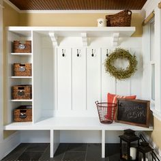 cubbies, bench, room for tall boots, a high shelf for decor or gear