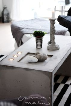 Concrete coffee table with holes for candles