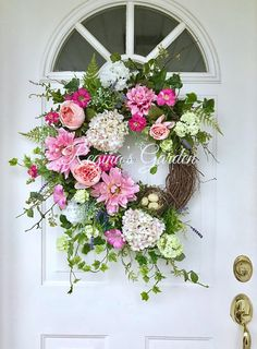 A lush gathering of beautiful garden blooms beckons the longer days of spring and bids farewell to the cold and dark of winter. Gorgeous blossoms, including pink and white variegated hydrangea, French lavender, peach blush and pink roses, green and white snowball viburnum offer a