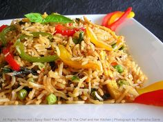 """Spicy Thai Basil Fried Rice 1 cup Jasmine Rice (I used Basmati Rice) 1 cup packed Thai basil leaves, washed ½ cup sliced red onions ½ cup sliced green peppers ½ cup sliced red and yellow peppers ¼ cup frozen peas ½ cup baby corn strips 5 cloves garlic, minced 1"""" piece ginger, grated 3 tbsp Sambal oleak(I used red chilli paste instead) 2 tsp Sriracha (I used tabasco) 2 tsp Dark Soy Sauce 1 ½ tbsp Brown Sugar 3 tbsp Olive oil Salt to taste"""