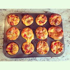 Breakfast Muffins: 8 eggs 5 slices of lean ham. bacon or chicken 1/2 a cup chopped spring onion 1 cup chopped mushrooms 1 cup chopped cherry tomatoes Olive oil Mixed herbs, salt & pepper  In a frying pan toss all the meat and veggies into a tablespoon of olive oil to cook along with herbs. salt and pepper.  Beat your eggs together in a bowl  Add the cooked ingredients and pour it into a muffin tray.  Bake in a preheated oven at 200C for 15 - 20 minutes  You can eat them hot or cold