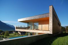 Built by k_m architektur in Schaan, Liechtenstein The property is located on the slope overlooking the Rheintal. The house faces south and offers a sublime view of the. Architecture Résidentielle, Wooden Facade, Floating House, Home And Family, Family Homes, Decoration, Villa, House Design, Photos