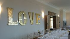 'Love is in the air'...literally! with these huge gold letter hung behind the top table.
