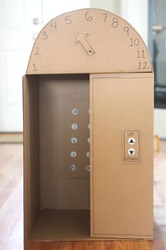 Repeat Crafter Me: Cardboard Box Elevator with Push Buttons. My kids would love this!!!  This should be marketed in a plastic version. The pretend play would be amazing.