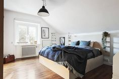 Scandinavian Attic Apartment Filled With Art
