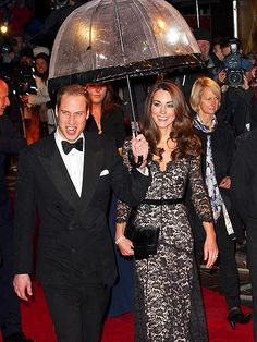 ROYAL ENTRANCE    Rain check! Ever a gentleman, Prince William keeps his glammed-up wife, Duchess Kate – who turns 30 today – dry while attending Sunday's premiere of War Horse in London.