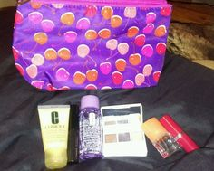 """This 6 piece set includes : 1 Cosmetics Bag, as shown in photo, purple with cherries all over , 1 Take off the Day: Makeup Remover1.7 Fl. Oz., 1Dramatically Different Moisturizing Lotion:1 Fl. Oz. Different Lipstick: GINGER FLOWER, 1 High Impact Mascara: BLACK1 Clinique """"HAPPY"""" perfume spray.1..."""