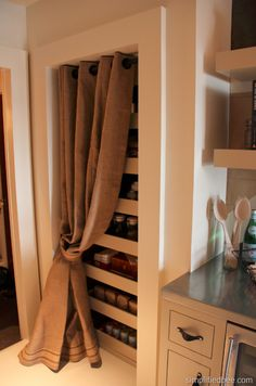 burlap curtain pantry- the door to my pantry is always open and I don't like it at all! I have been considering taking it down- now I just might!