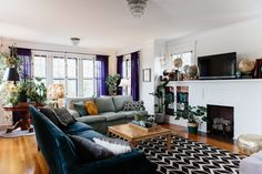 The velvet couch from the Nebraska Furniture Mart is paired with a light blue couch, a hand-me-down from Elizabeth's parents. The throw pillows in the living room are a mix of Target, Urban Outfitters and Homegoods.