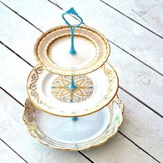 """Anastasia Cake Stand - Top tier: 6.5"""" diameter. Middle tier: 8"""" diameter. Bottom tier: 9.5"""" diameter. Total height: 15"""". Hand-drilled. Hardware: enamelware. Made of repurposed vintage estate china dating back to the 1930s. ($119/$168 retail)"""