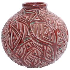 Axel Salto stoneware vase in oxblood glaze decorated with branches in relief. Produced by Royal Copenhagen, Denmark. Painted under the glaze with blue wave mark, incised in the body 'SALTO'. 1970s