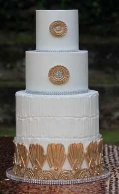 White and gold cake by Joshua John Russell