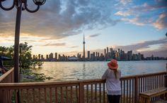 The beautiful Toronto city skyline at sunset with the CN Tower dwarfing every other building. This was taken from Toronto Island with a fisheye lens.
