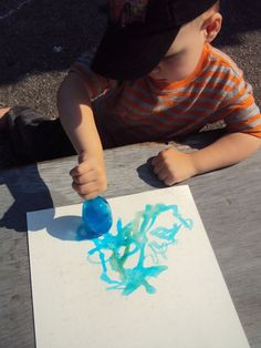Painting with Colored Ice. A great outdoor summer activity.